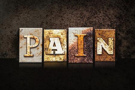pain written in letterpress letters