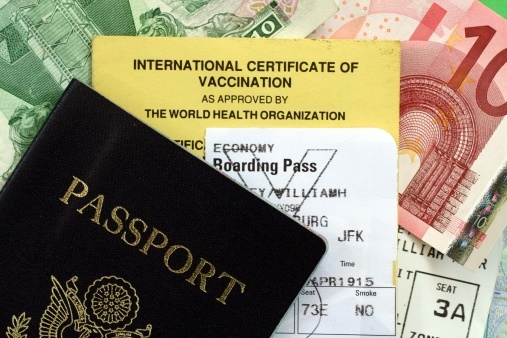passport and vaccine travel documents - ThinkstockPhotos-140260217.jpg