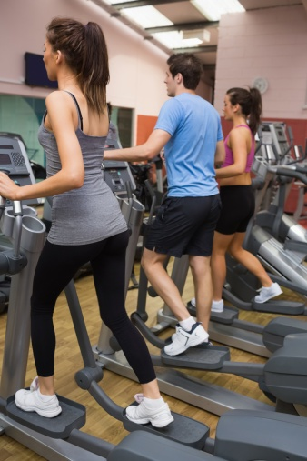 people on exercise equipment