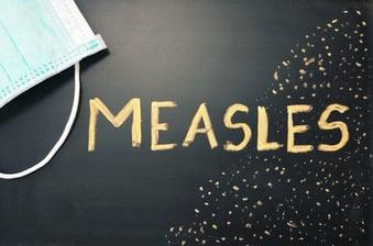 measles written on blackboard