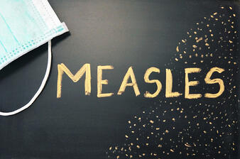 measles written on blackboard