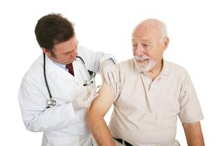 senior man getting flu shot - shutterstock_9662044