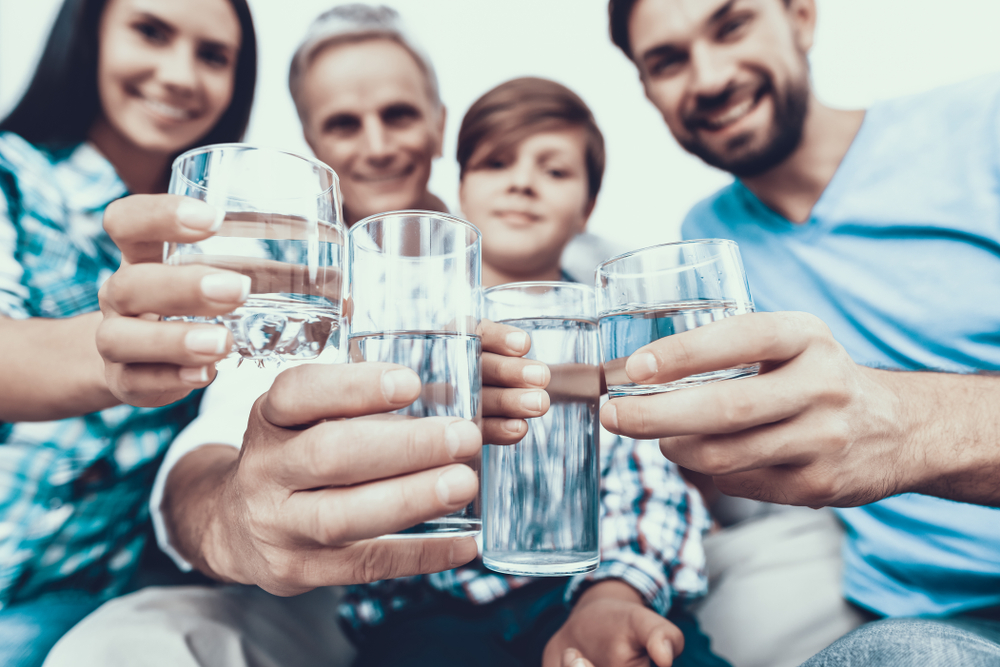 smiling family drinking water