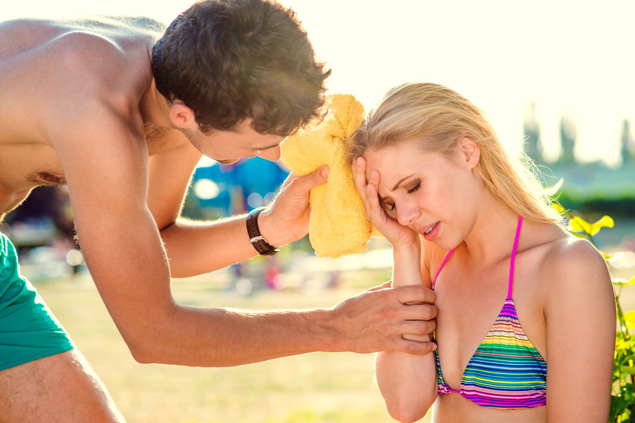 young woman with heat stroke